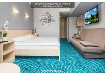 Стандарт улучшенный с одной кроватью и диваном | Отель Ялта-Интурист