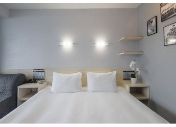 Стандарт улучшенный с одной кроватью и креслом | Отель Ялта-Интурист